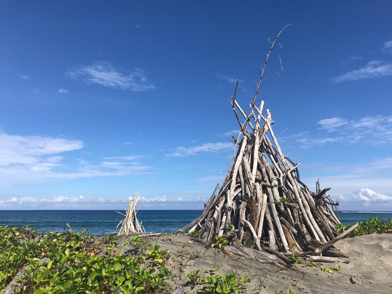Driftwood teepees on the beach. Currently looking for a roommate! ;)