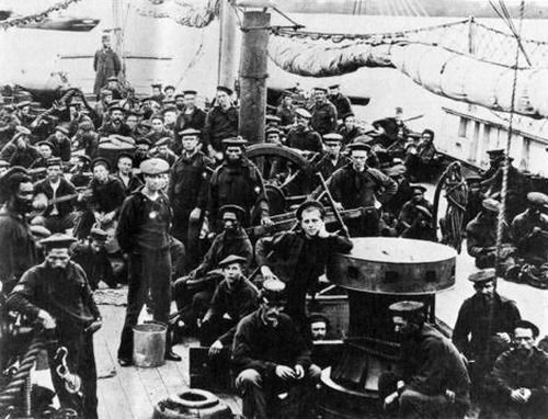 Black and white Union soldiers photographed on the USS Miami