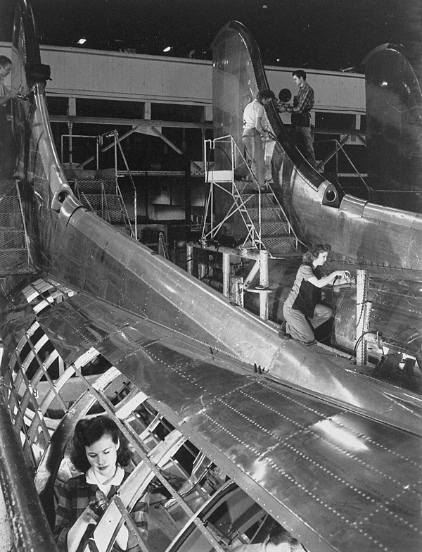 Boeing workers riveting parts to the fuselage of B-17G aircraft.  Image courtesy of  Tom Philo