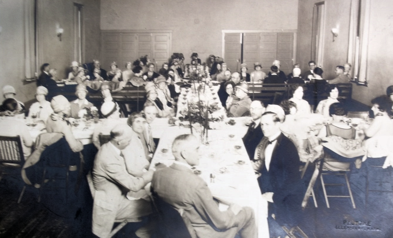 21st Annual Meeting of the Washington Tuberculosis Association (WTA). Ellensburg, WA 1927 (the table is set up in the shape of a double-barred cross--the international symbol of the anti-TB movement)