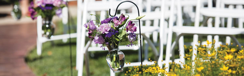 Beautiful flowers on display in Eastland Suites Courtyard for a wedding.jpg
