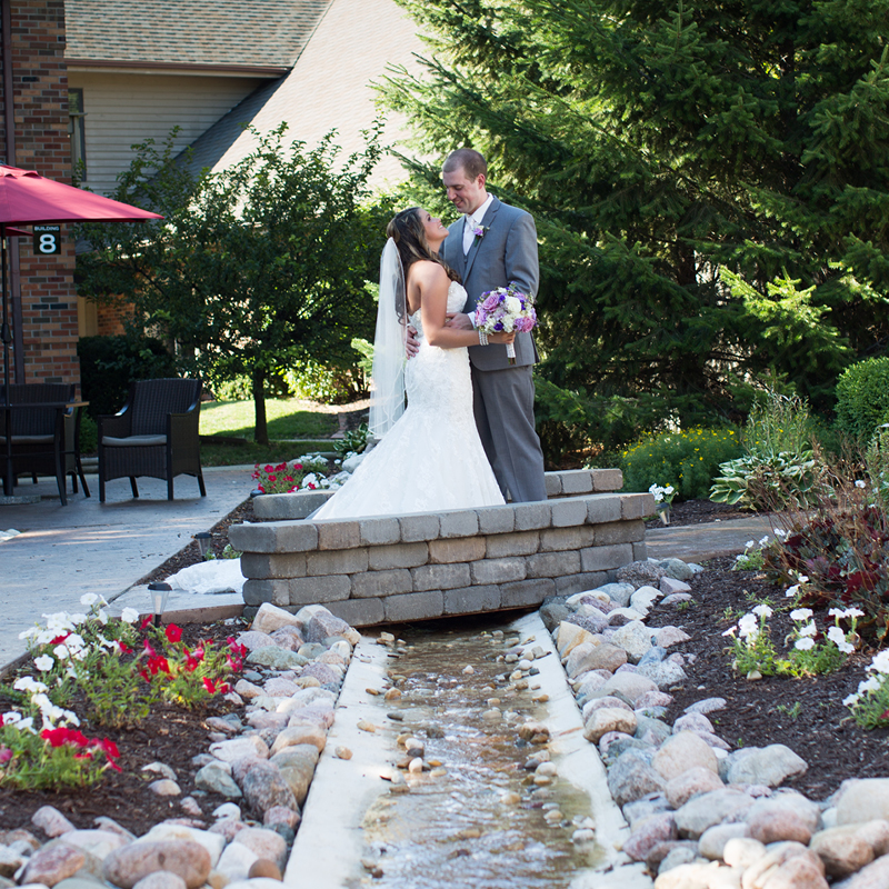 Couple in our beautiful outdoor courtyard at Eastland Suites Bloomington, IL.jpg