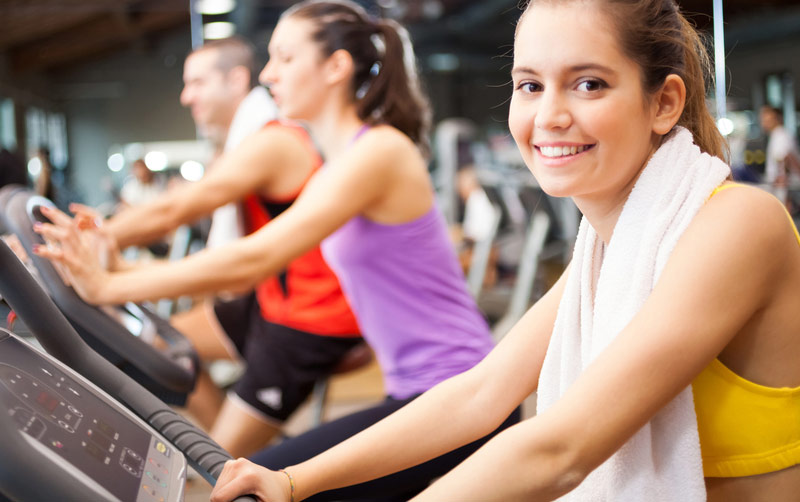 people-working-out-in-gym-with-cardio-equipment.jpg