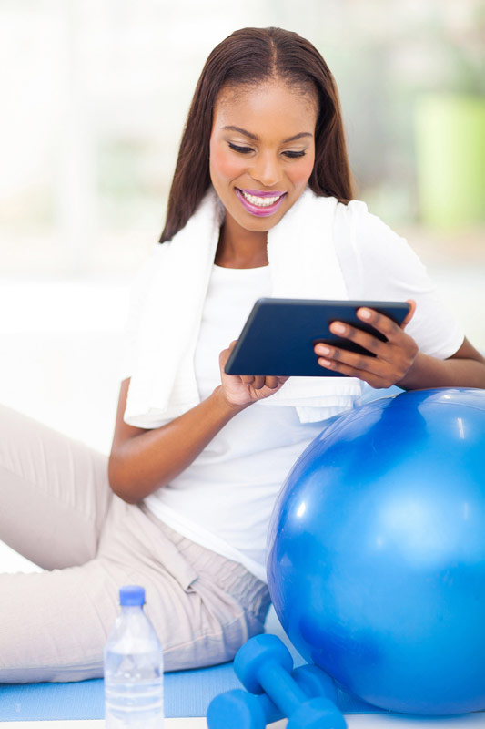 african-woman-with-exercise-ball-and-tablet.jpg