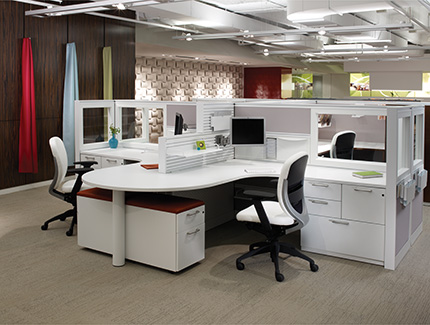 Xsite panel system with Footprint worksurfaces and storage, and Wish seating