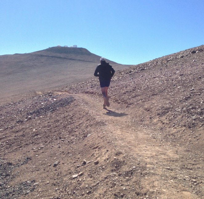 Running toward the Very Large Telescope at the Atacama Desert in Chile