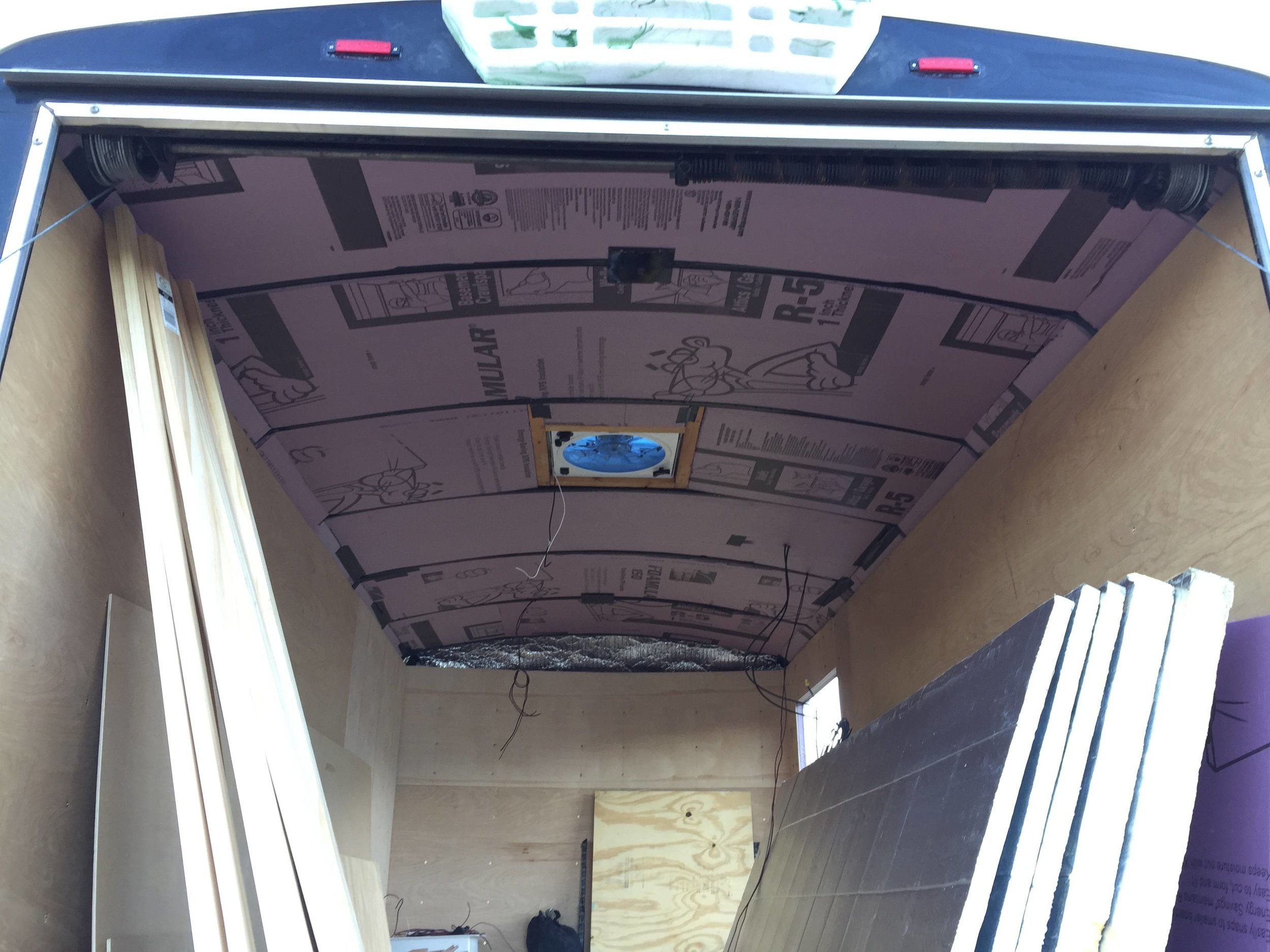 The first layer of ceiling insulation is in, in between the roof ribs. If I stopped here, those ribs would get too hot to touch for more than a couple seconds on a sunny day.