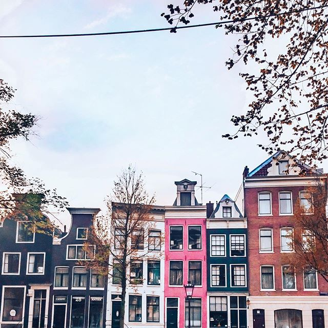 """𝐵𝑒𝓉𝓉𝑒𝓇 to see something once than to hear about it a thousand times.""♥ᴬˢᶦᵃⁿ ᴾʳᵒᵛᵉʳᵇ ⠀⠀⠀⠀⠀⠀⠀⠀⠀ Thoughts on exploring Amsterdam as a solo female traveler: Two days was a perfect amount of time for me to be here alone. To be honest though, I could have spent at least a week here maybe with Mike and or friends and given myself some more down time between sightseeing (I walked an average of 9 miles a day!) and done some other activities that didn't seem as fun alone, like going out to dinner or drinks at night. ⠀⠀⠀⠀⠀⠀⠀⠀⠀ In spite of it's hedonistic reputation among Americans, Amsterdam is quaint, charming, safe and friendly. There is so much to do beyond the infamous Red Light District and ""coffee shops"" it is stereotypically known for. ⠀⠀⠀⠀⠀⠀⠀⠀⠀ I'll be sharing more about what I did during my time here through the next several posts and will be working on a little guide for my blog. One of the things I enjoy about a new city is observing all of the architecture. I loved the different gables on top of the quirky Amsterdam canal houses like these! Which one would you pick? (I think you can guess my choice!) • • • • • • • • #solotravel #solofemaletravel #architecture #tlpicks #holland #netherlands #iamatraveler #girlsthatsparkle #dutch #dutchtravel #dutchhouses #canalhouse #dametraveler #visitamsterdam #femmetravel #Iamsterdam #girlsborntotravel #girlaroundtheworld #girlsabroad #travelgirlsgo #thetravelwomen #ladiesgoneglobal #girldiscoverers #pinktrotters #sheisnotlost #traveladdict #discoverunder5k #openmyworld #girlytravel"