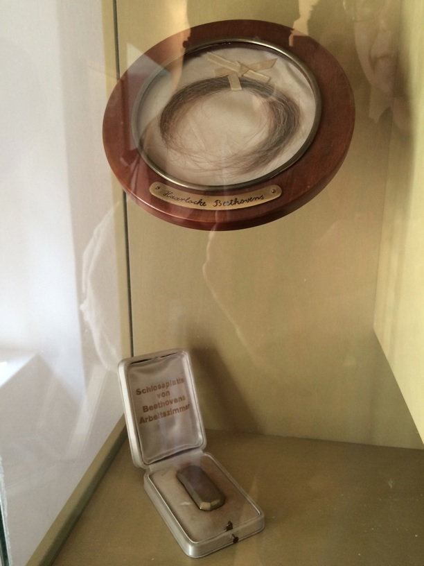 Bizarre relics in the Heiligenstadt museum—a lock of Beethoven's hair and the lock plate from his work study.