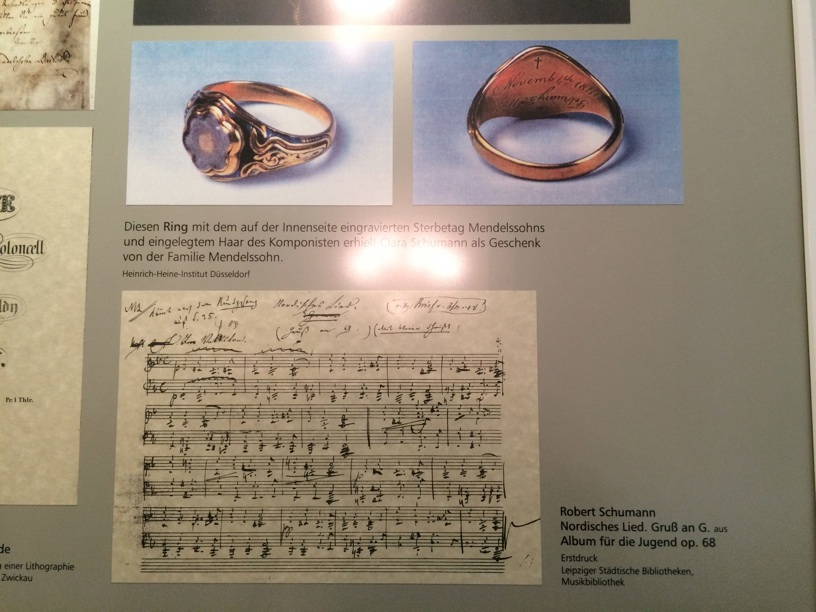 Ring given to Clara with a lock of Mendelssohn's hair!; below, manuscript from Robert's piano piece Nordisches Lied from Album for the Young