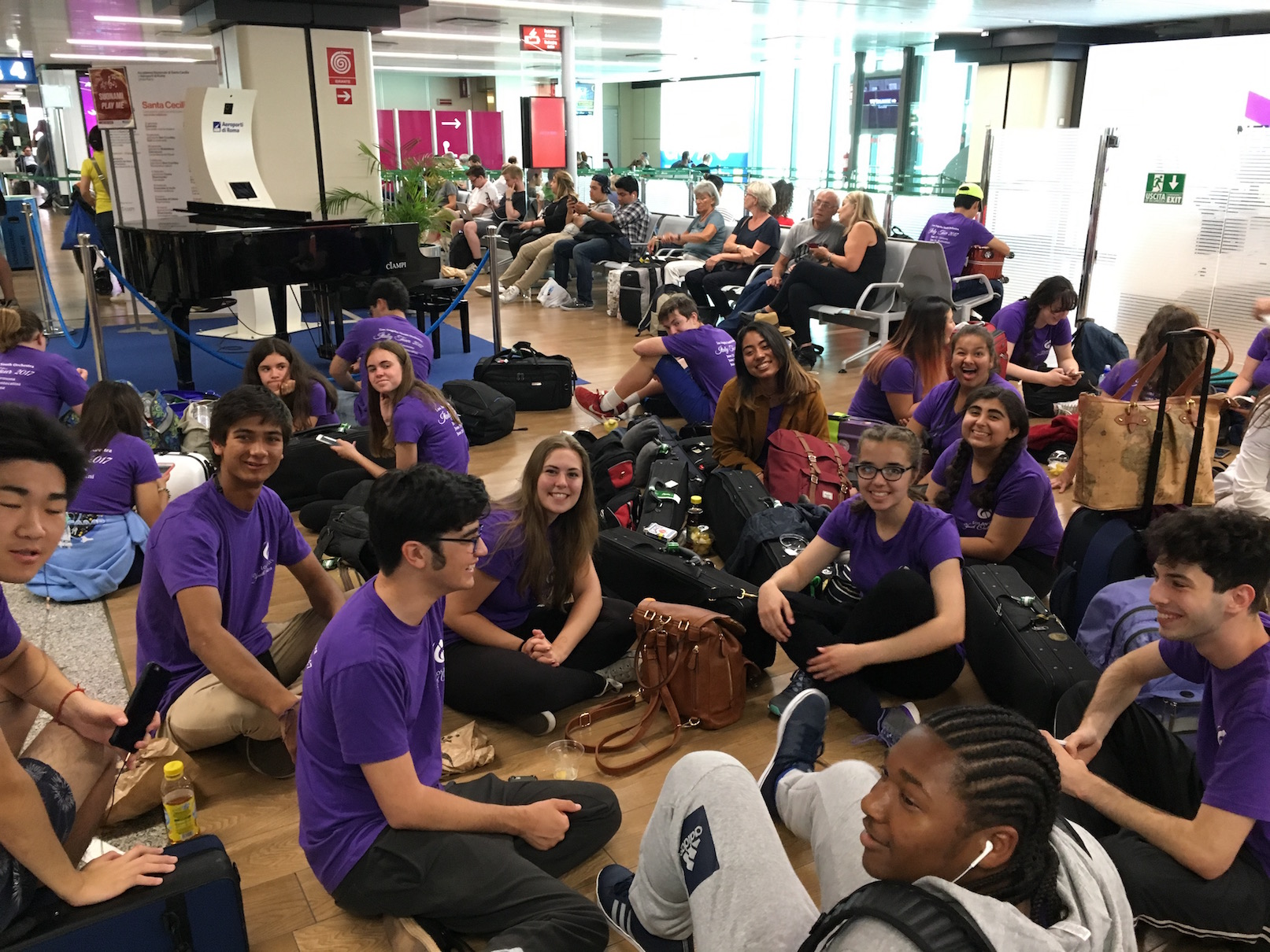 Despite a 6 hour delay at the airport, LAYO students just chill on the floor getting to know each other better.