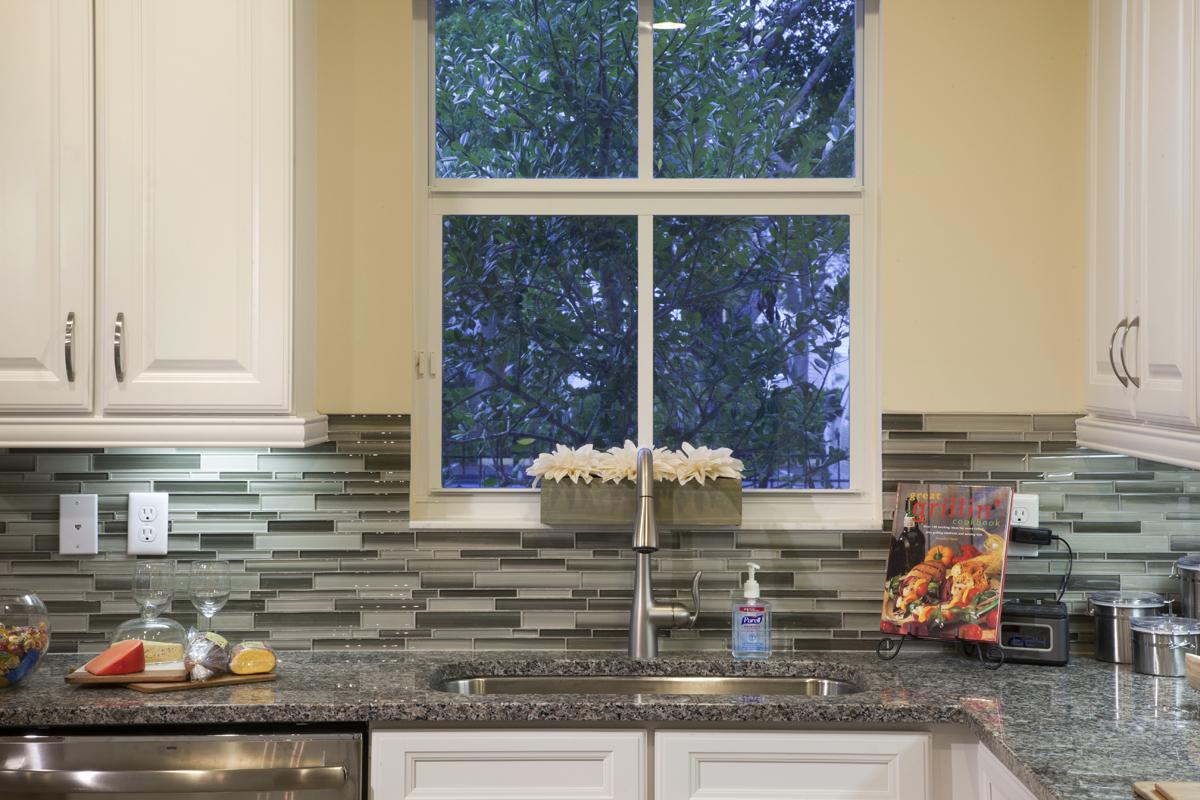 A glass tile back splash is a beautiful kitchen detail.
