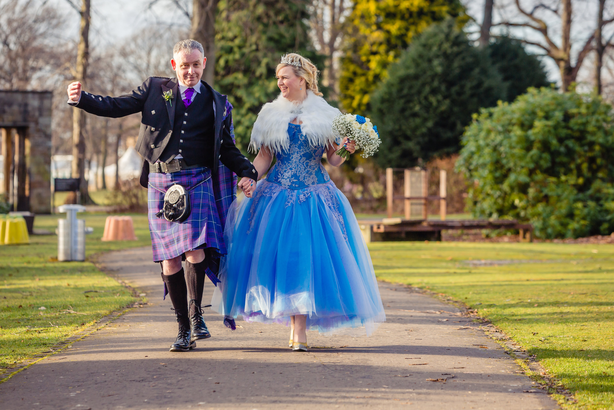 Laura and John. Laura had a stunning blue to violet shot silk corset hand appliqued with silver Solstiss lace and a layered tonal tulle skirt with dipped hem. Image by Mike Cook Photography