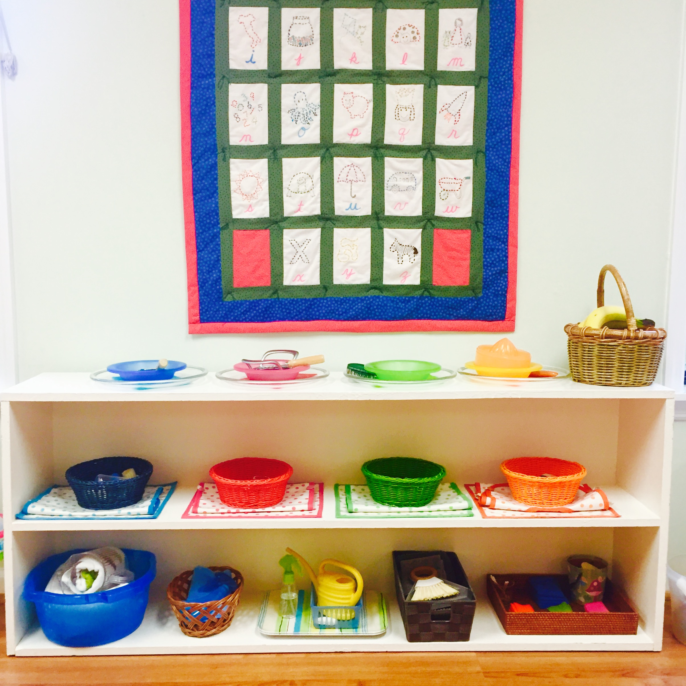 The beauty and simplicity of the Practical Life shelves invite children of all ages to take care of their classroom.