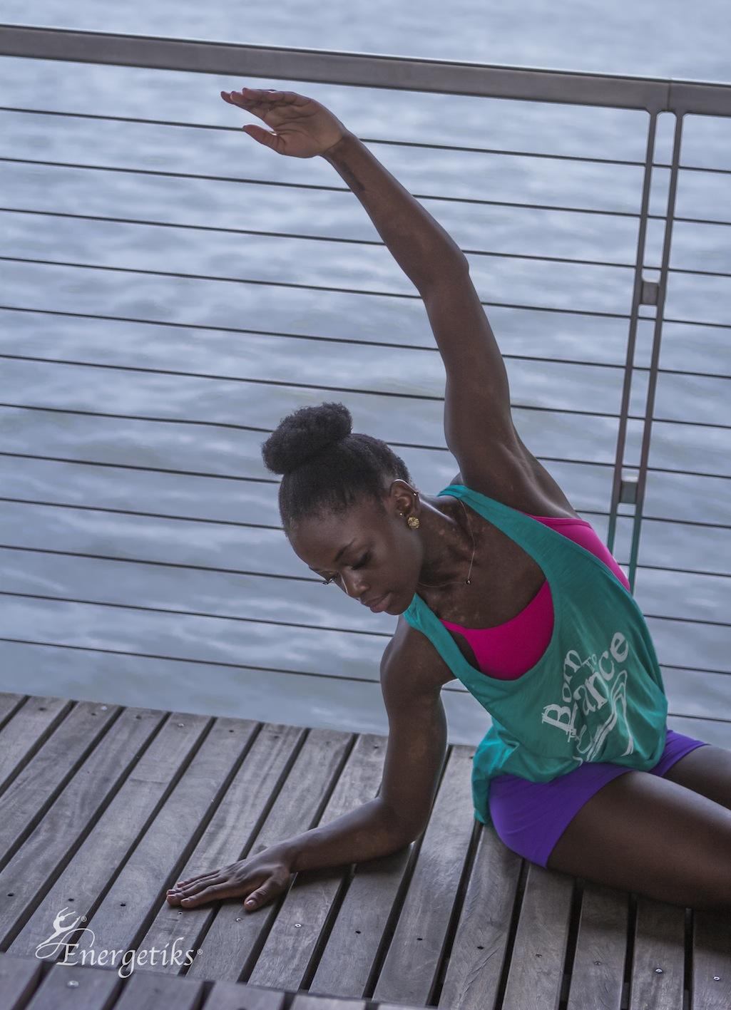 Michaela wears Energetiks Flow Dance Singlet, T Back Crop Top and Straight Band Short