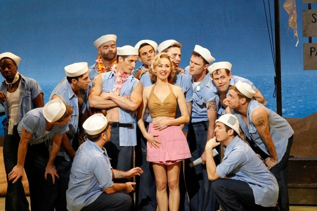 Lisa-McCune-as-Nellie-Forbush-with-the-boys-of-Opera-Australias-SOUTH-PACIFIC-Photo-by-Jeff-Busy