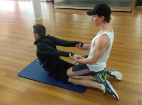 Image: pennylomas.com.au   2.  This stretch is great for releasing the anterior hip muscles (hip flexors/iliopsoas, adductor longus and rectus femoris). Be careful not to 'crunch' the spine by sinking back, but rather keep lifted and think of pulling up and out of the hips as your partner gently pulls your upper body off the floor and back towards your feet.