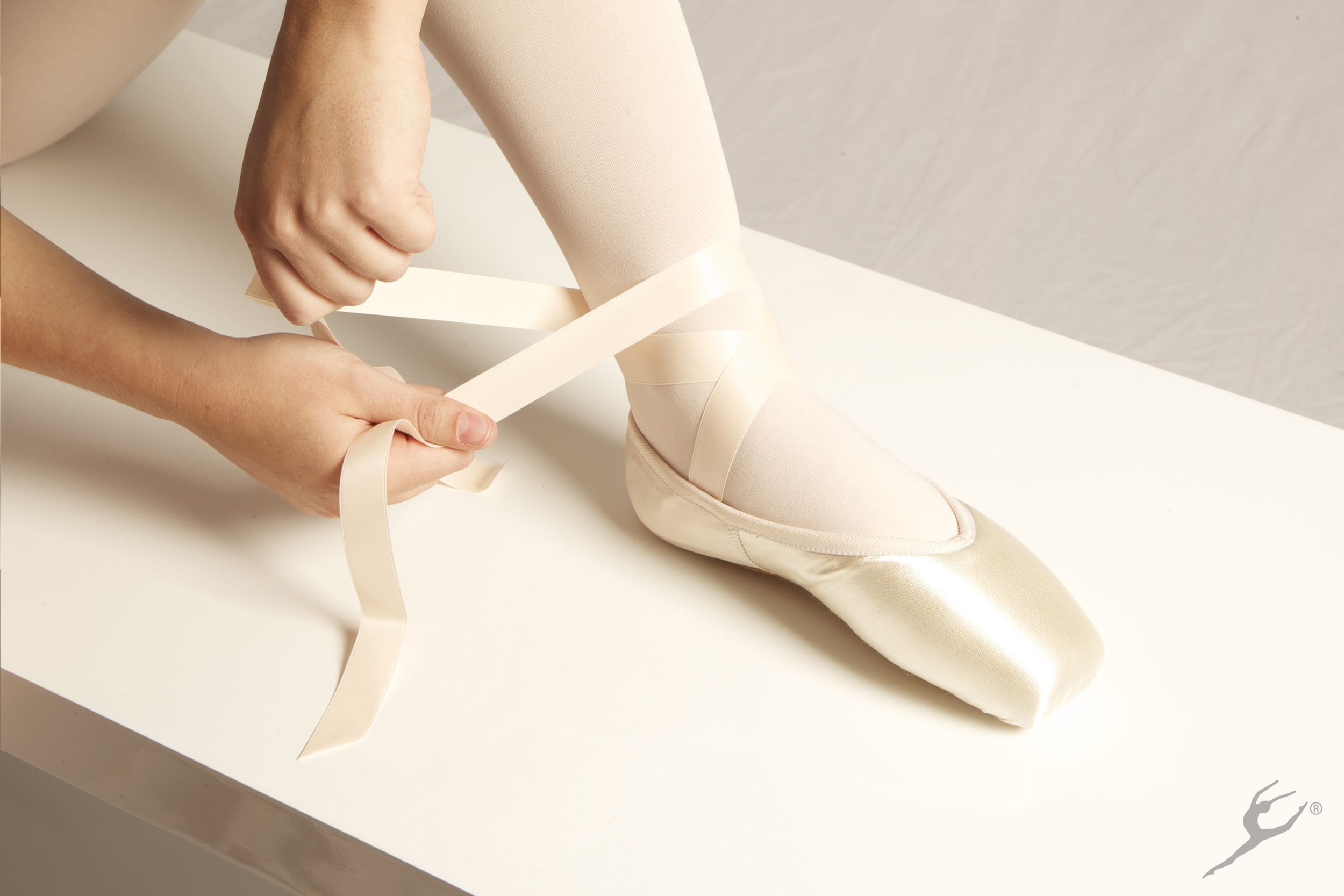 6: Repeat the process from the first ribbon, by wrapping the 2nd piece around the back of the ankle
