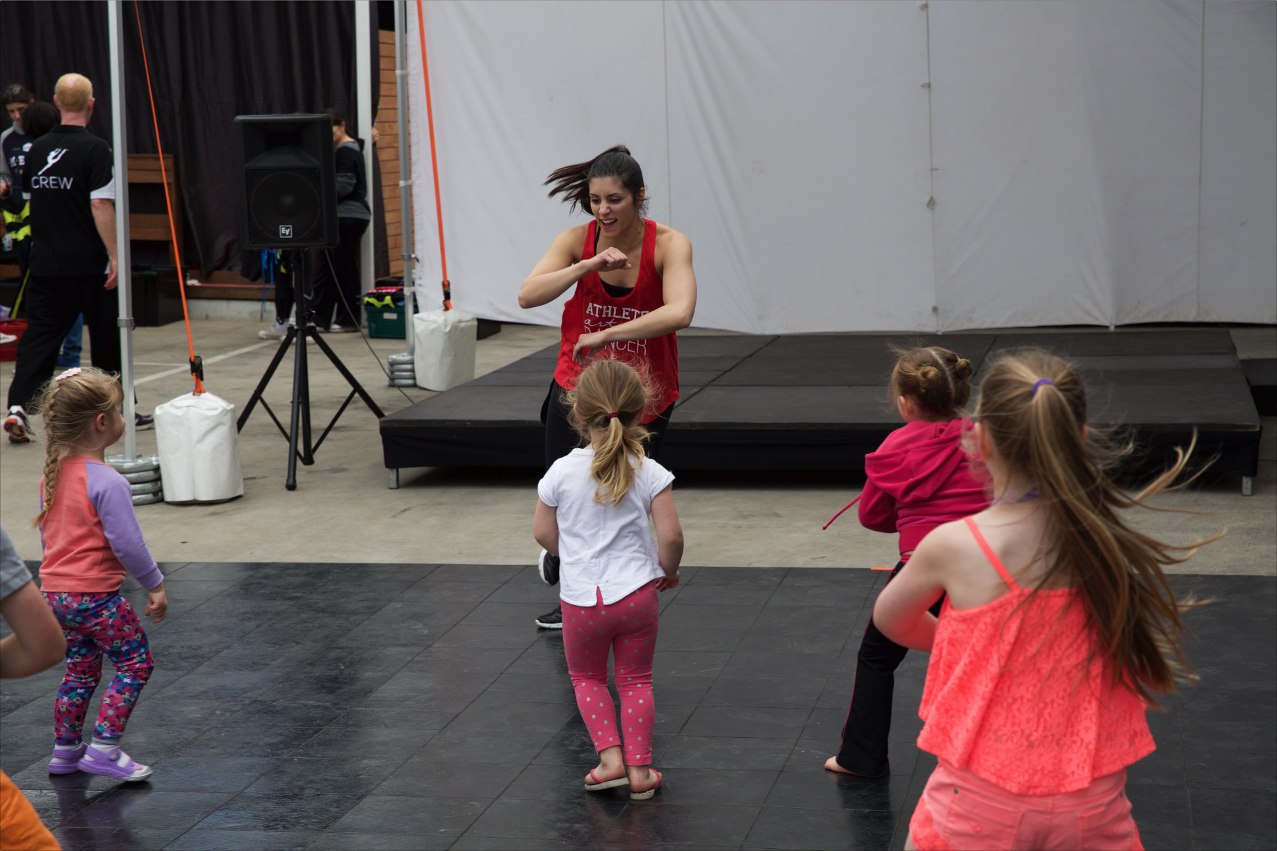 Christina shows of her muscles during Hip Hop class!