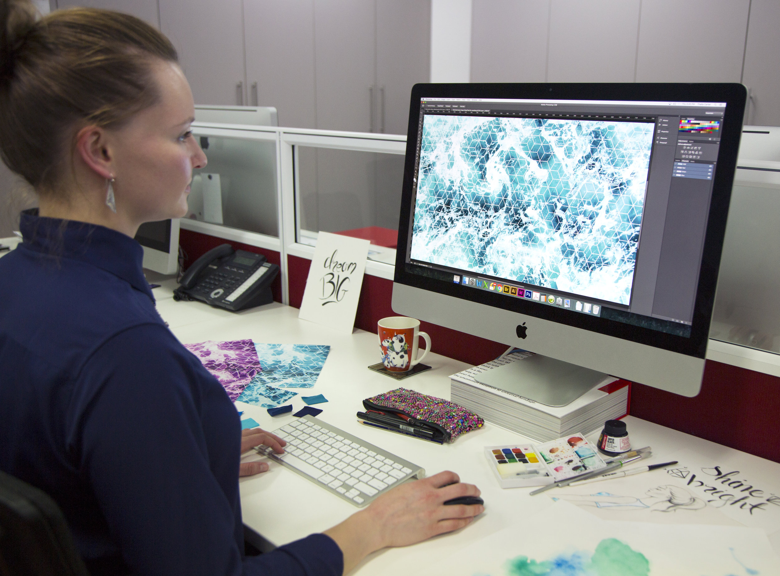 Graphic Designer Thalia Carter working on the Crystal Tide print
