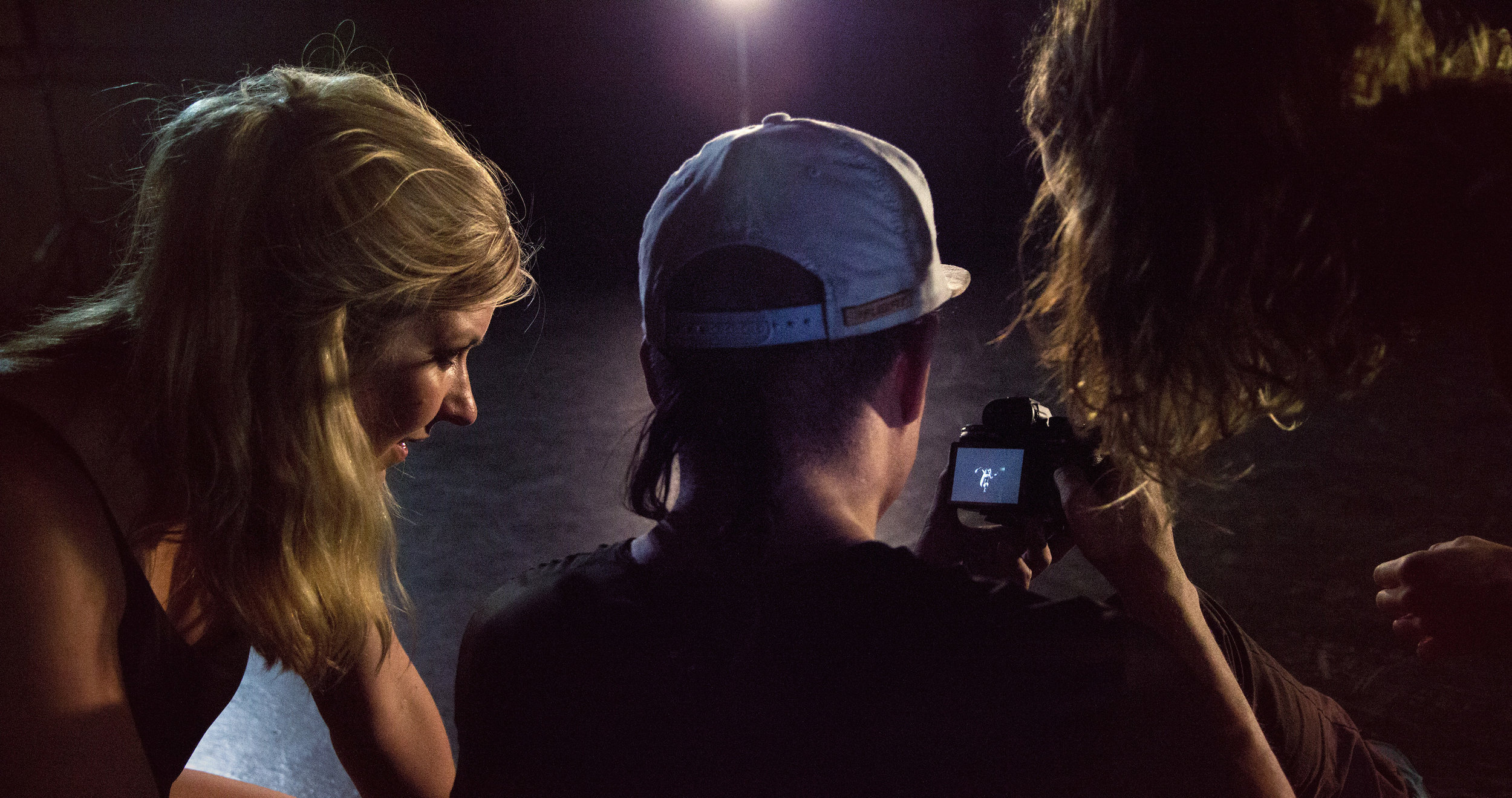 Sarah (left) with videographer Frace Luke Mercado and Dream Dance Company member watches back footage during filming for Enter the Vortex's promotional release.