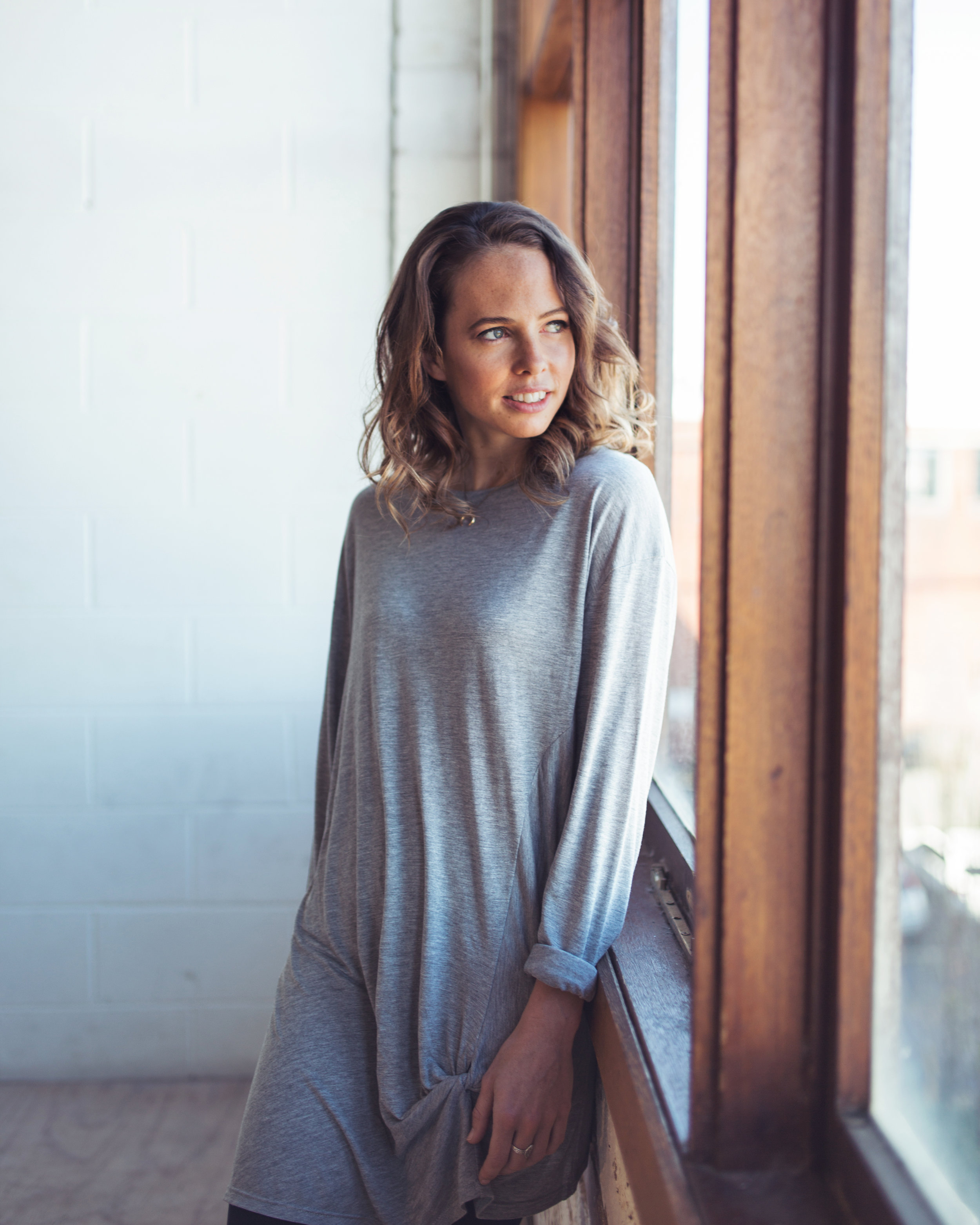 Lucy wears the  Aubrey Knot Long Sleeve Tee  from the Atelier Collection