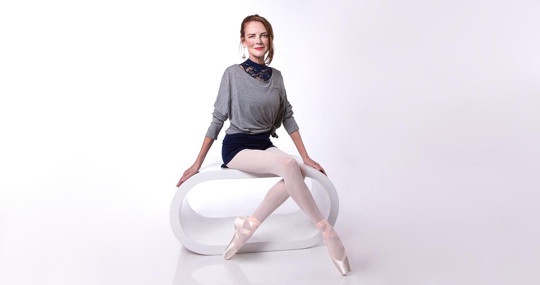 Carol wears the  Scarlett Leotard  in Navy,  Studio Pullover  in Grey Marle,  Merino Wool Roll Top Short  in Navy, and Energetiks  Sapphire  Pointe Shoes