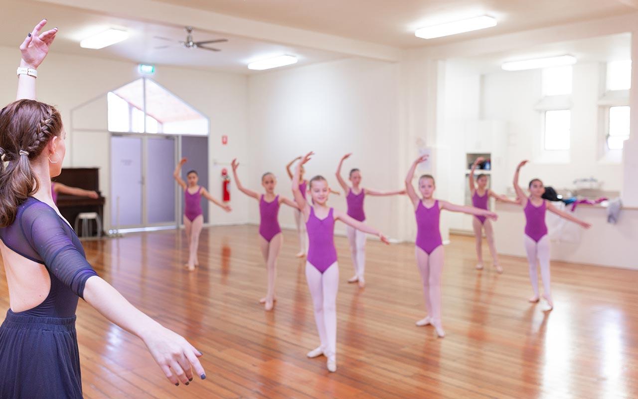 Georgia teaches class at Dance Partners, wearing the  Rhea Leotard  and  Sadie Volume Short  in Cosmic