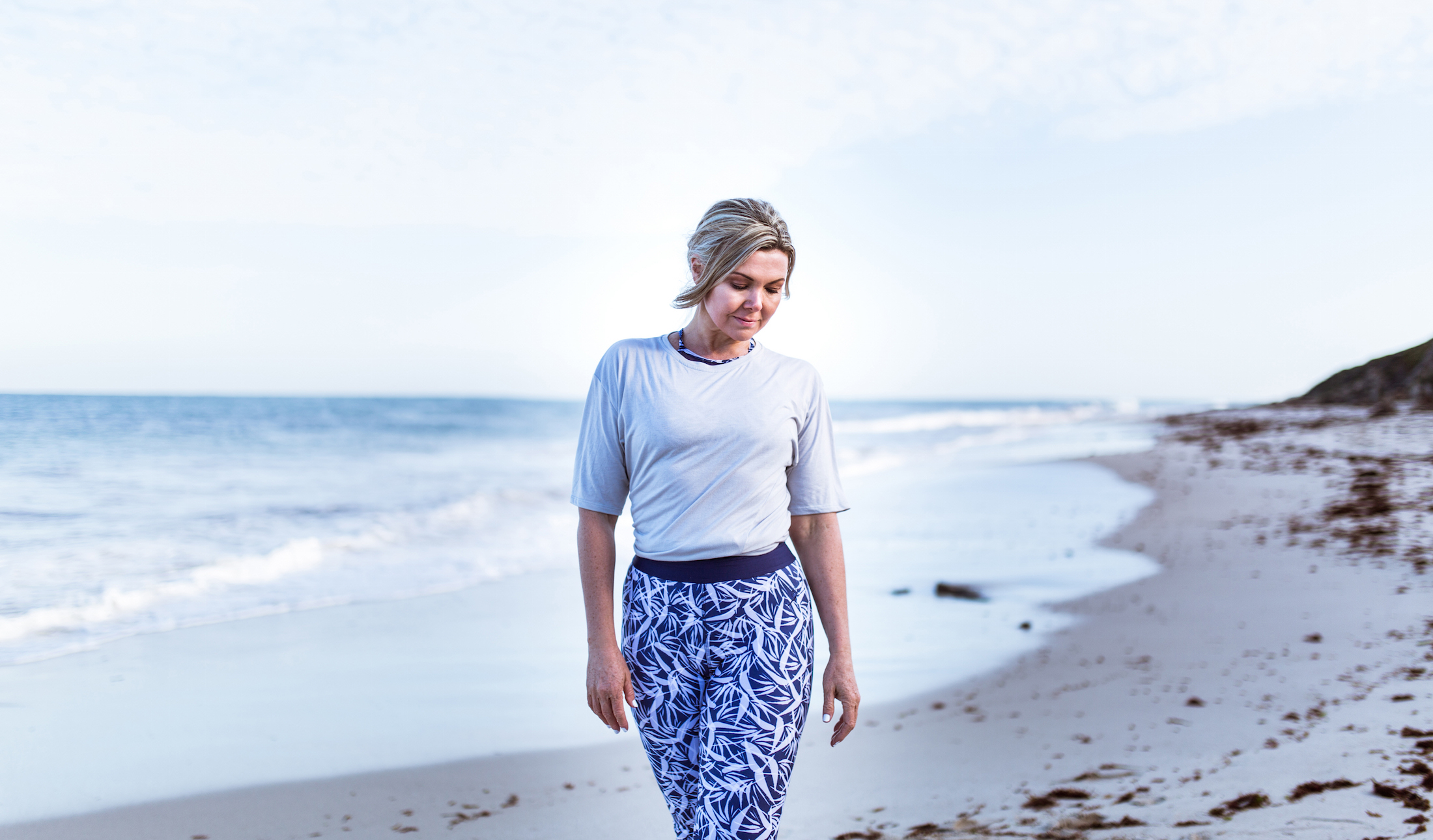 Sophie wears the  Hailey Knot Tee  in Platinum and  Billie Legging  in Paradise