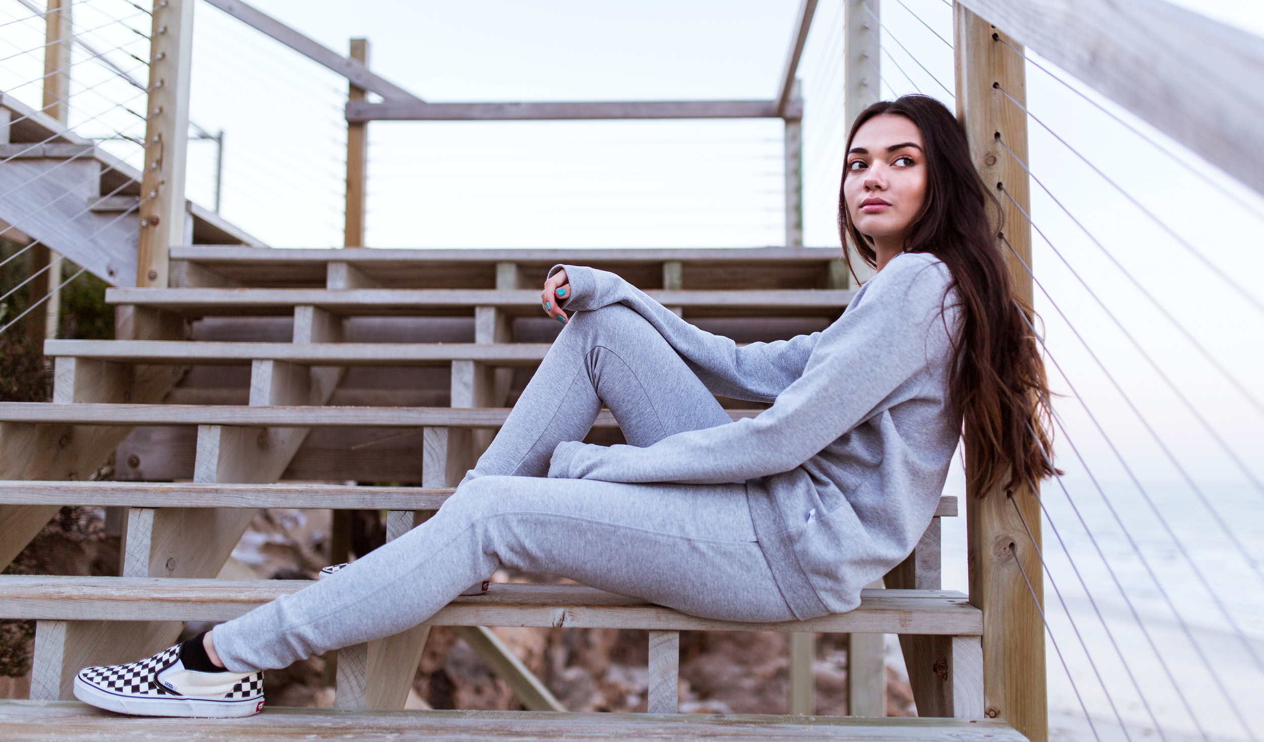Portia wears the  Delta Hoodie  in Grey Marle, and the  Avery Track Pants  from the Paradise Collection