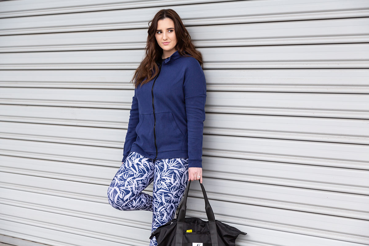 Lauren wears the  Jordan Jacket  and  Billie Legging  from the  Paradise Collection , with the  Dance Tote