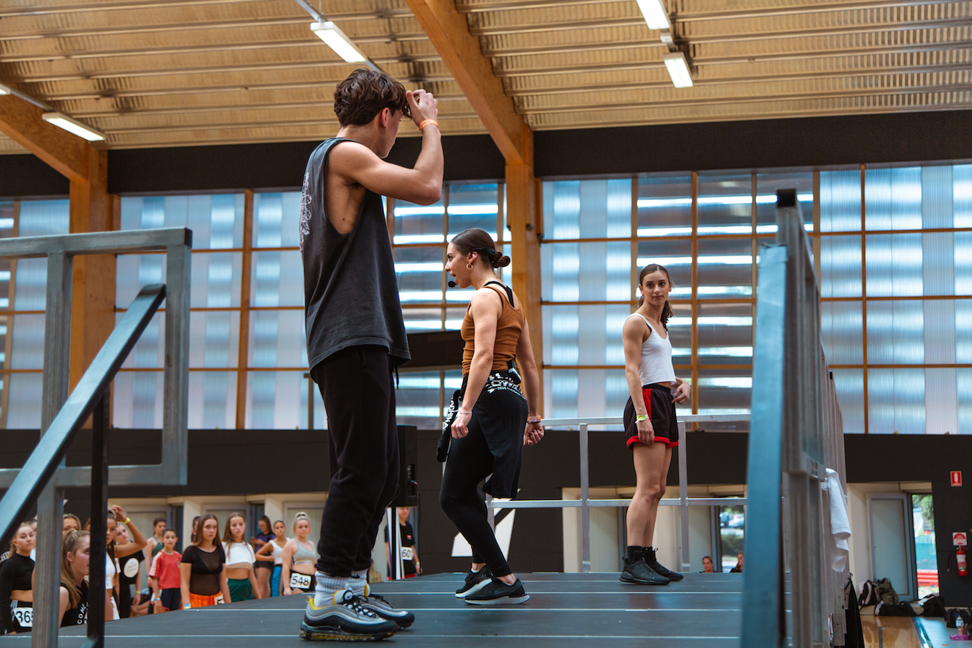 Dream Dance Company member Cat Santos taking class at ADF 2018, assisted by fellow Dream Dance castmate Maikolo Fekitoa