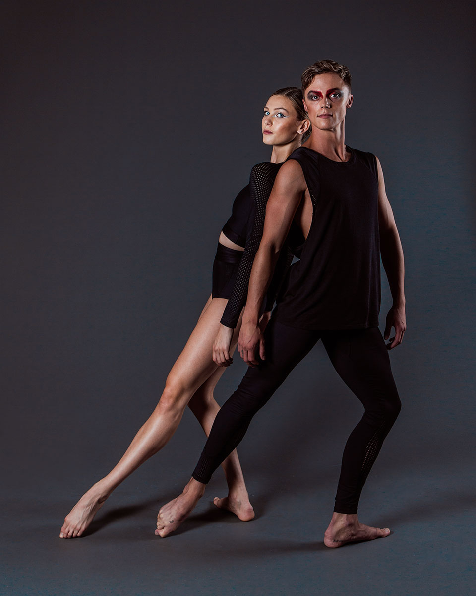 Zoe wears the  Xena Crop  and  Xena Brief  and Jack wears the  Alpha Legging  and  Aero Singlet  in Black.