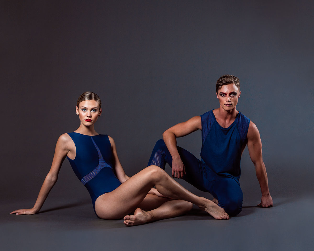 Zoe wears the  Misha Leotard  and Jack wears the  Alpha Legging  and  Aero Singlet  in Midnight Blue.