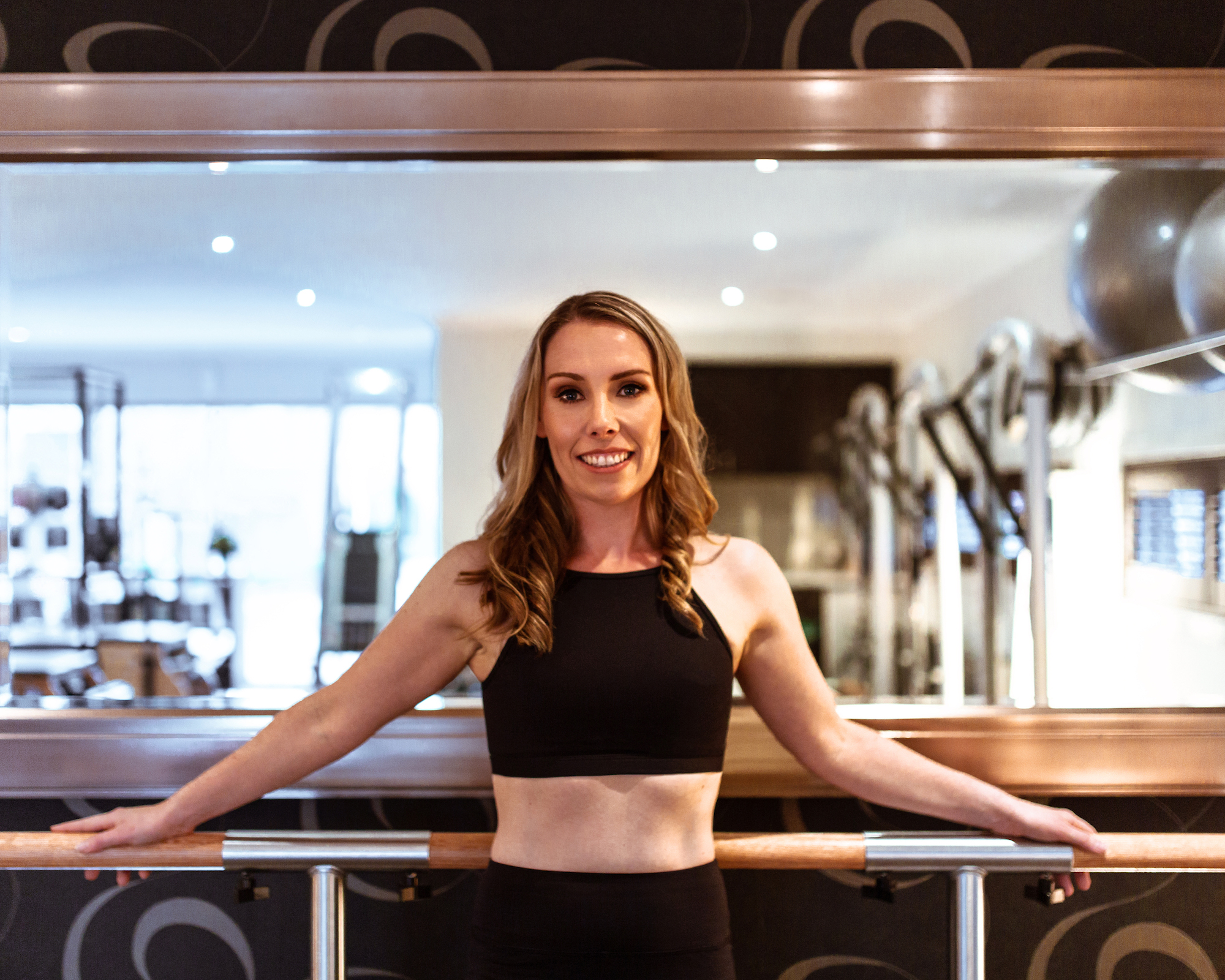 Kate wears the  Coco Crop  and  Piper 7/8 Legging  in Black.
