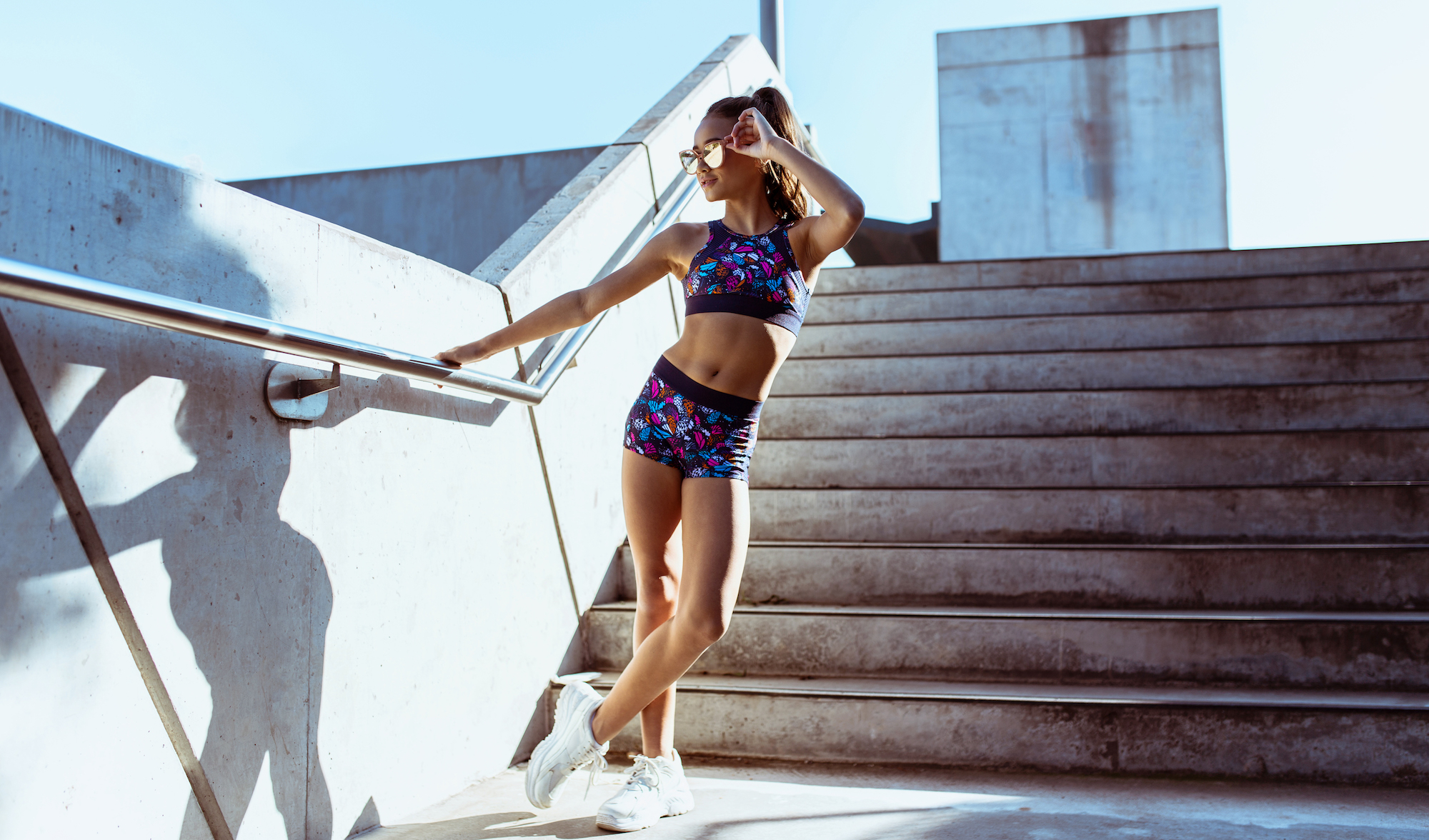 Mackenzie wears the  Violet Crop Top  and  Camilla Short  in Socialite