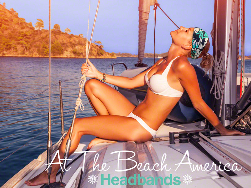 Woman wearing At The Beach America Headband on Sailboat.