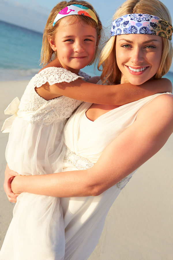 Mother and daughter wearing At The Beach America headbands