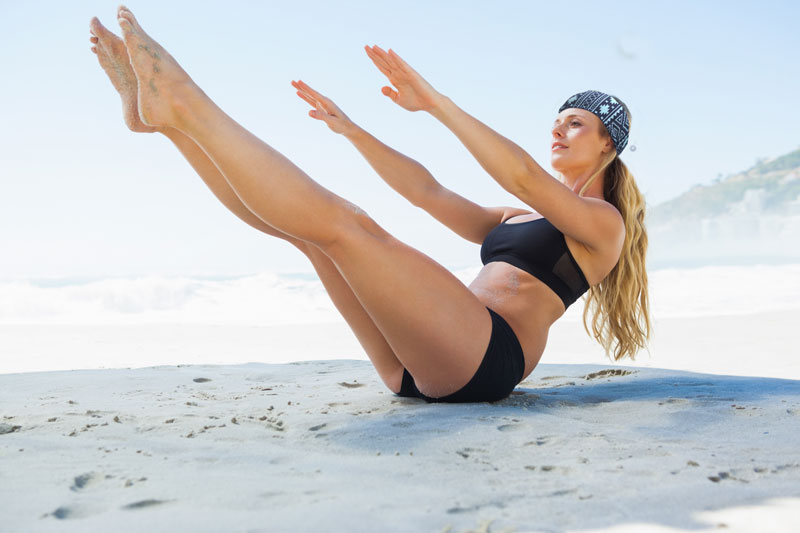 yoga-pilatys-women-model-on-beach-in-v-pose.jpg