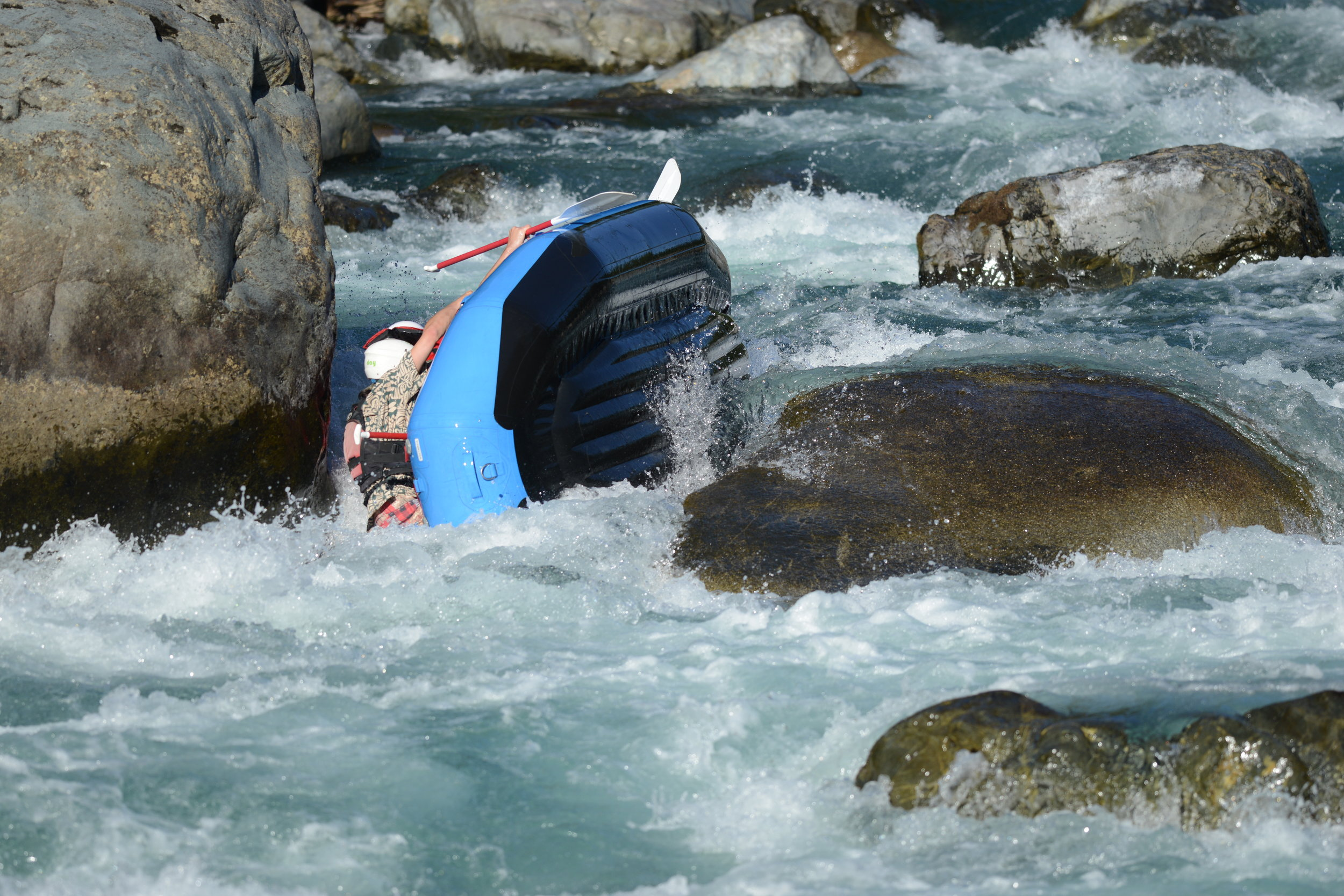 The NRS E-130A whitewater raft (action photo included for added effect)