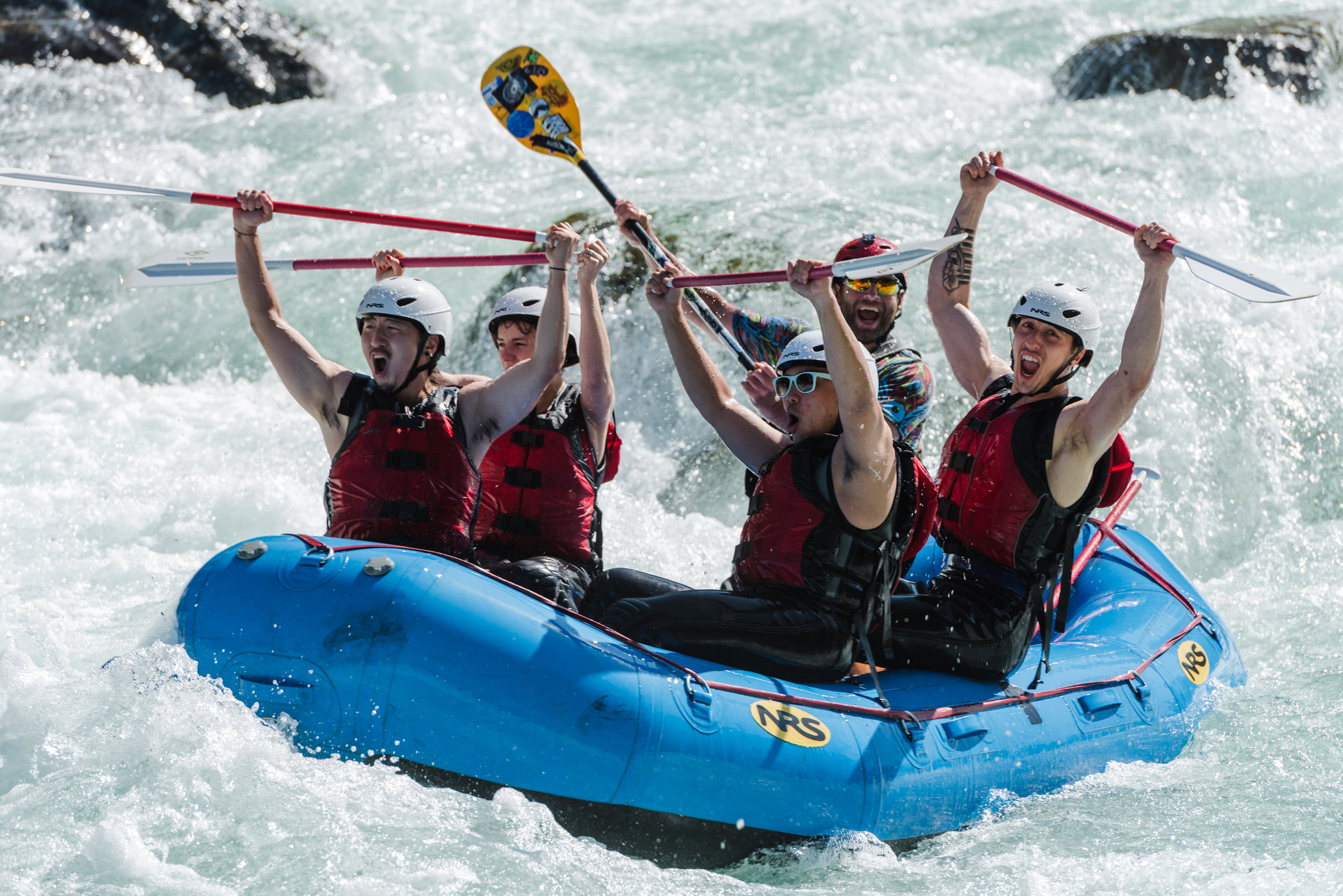 A group of Skykomish rafters after running the infamous rapid called Boulder Drop.