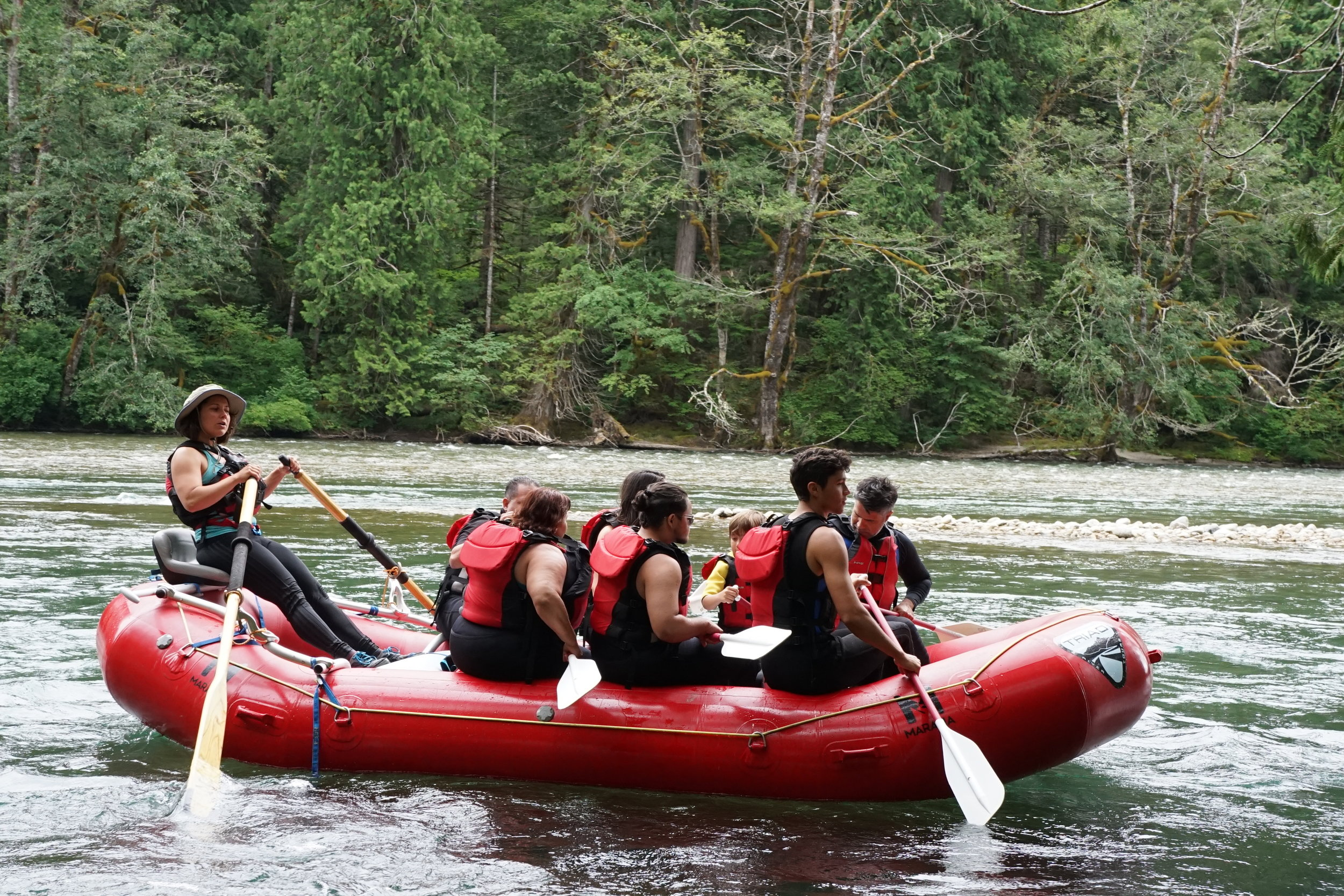 Here, our river guide, Danica, takes rafters down the Skagit River. She has been rafting for six years, and guiding for three.