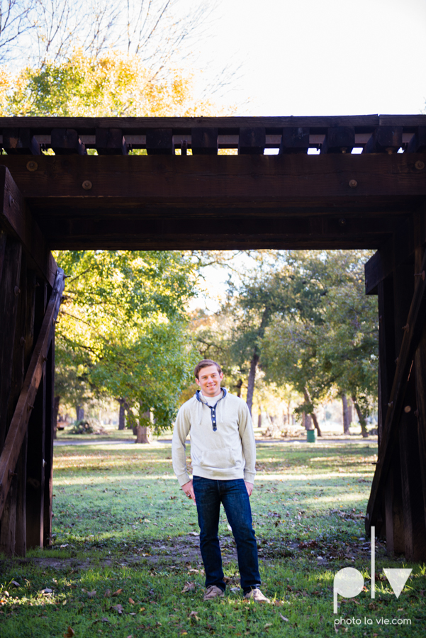 Andrew high school football player senior photos pictures downtown Fort Worth Trinity Park fall winter session sweater boy guy model Sarah Whittaker Photo La Vie-6.JPG