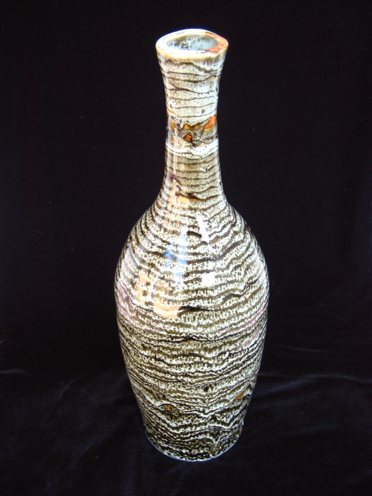"""Common Center in Temmoku  , 2003, wheel-thrown bentonite clay Fired at cone 10 reduction, 14 3/4"""" h x 4 3/4"""" dia"""