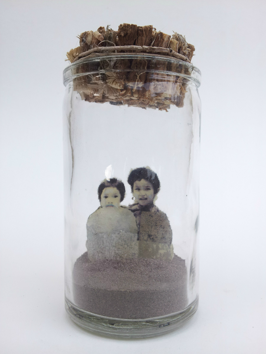 "One Sees Clearly Only With the Heart   No. 4 from  Little Princes  installation, 2014 Acrylic, ink, paper, plant roots, and sand in glass jar 4 ½"" height x 2"" diameter  Underside reads:   One sees clearly only with the heart. Anything essential is invisible to the eyes."