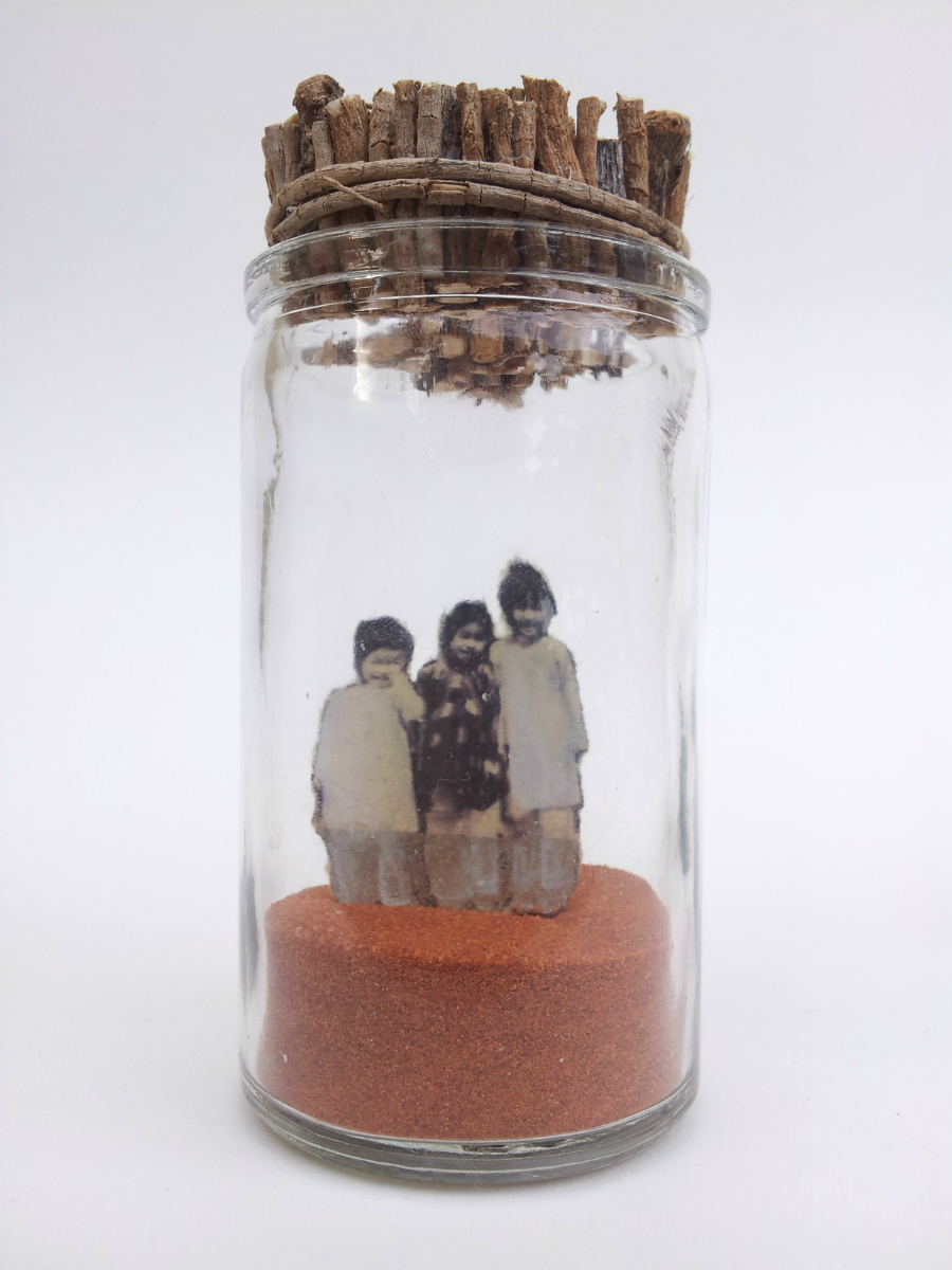 "Only the Children Know What They are Looking For   No. 5 from  Little Princes  installation, 2014 Acrylic, ink, paper, plant roots, and sand in glass jar 4 ½"" height x 2"" diameter  Underside reads:   Only the children know what they are looking for."