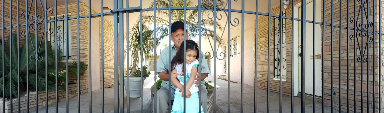 """meeting my neighbors:""""buenos dias, Señor. me llamo trinh, y soy un artista, nueva a santa ana. que hermosa es su nieta. puedo tocar su photo, por favor?"""""""