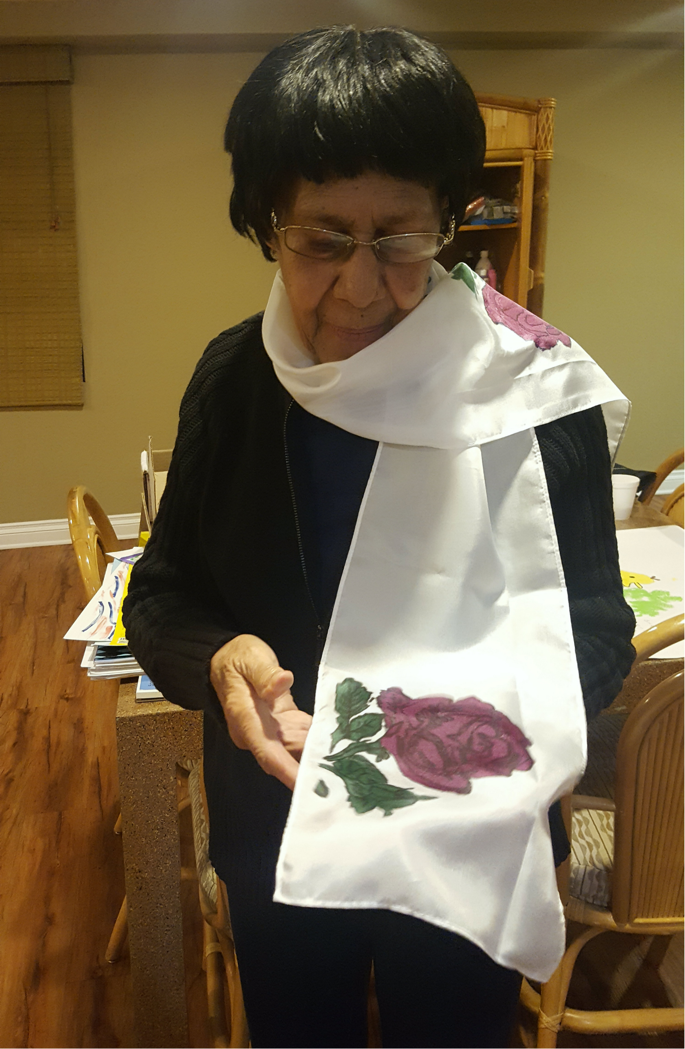 Beautiful ms. Rose renders a beautiful rose on her silk scarf