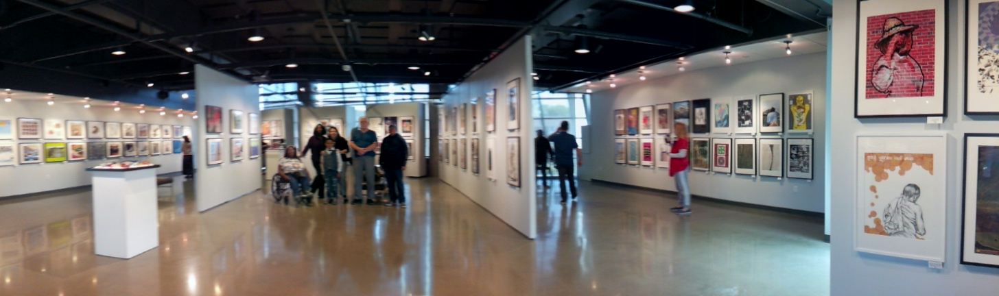 The Heninger Villagers stand together among their works on display at the beachfront Coastline gallery in Newport Beach, CA