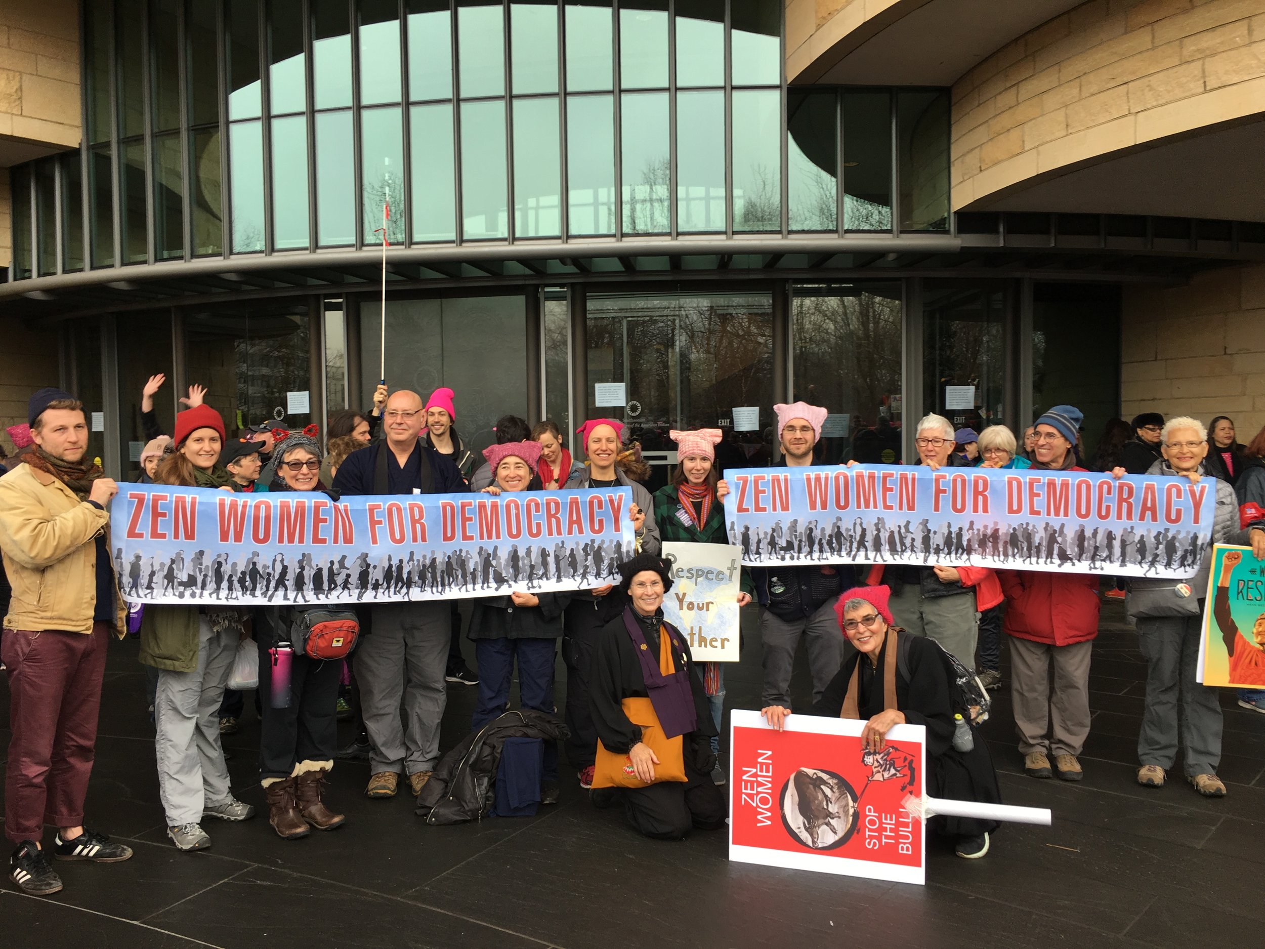 Audrey Charlton on the far right holds the banner with some of the many Zen practitioners who joined the march